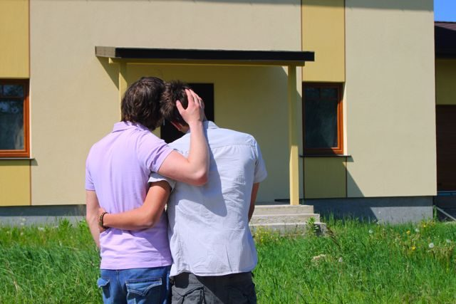 gay couple moving into their own house
